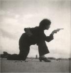 Woman soldier shooting pistol during Spanish Civil War