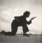 Woman soldier shooting pistol during Spanish Civil War